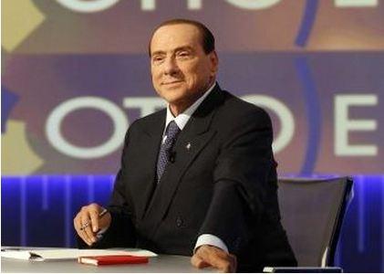 Berlusconi  trucco doppio cuscino
