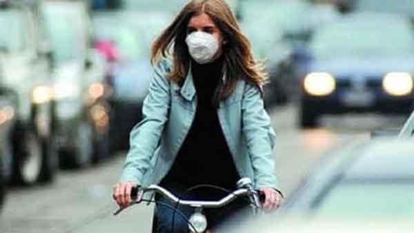 mascherina Coronavirus in bicicletta